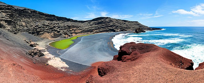 Red sand beach in fishing village