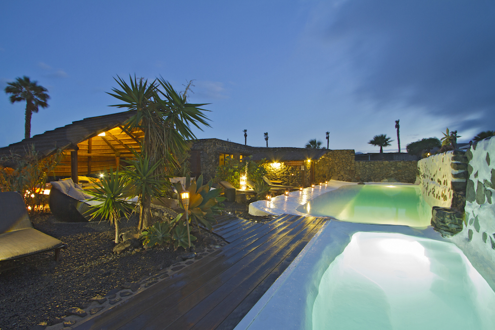Shared pool by night at Finca De Arrieta